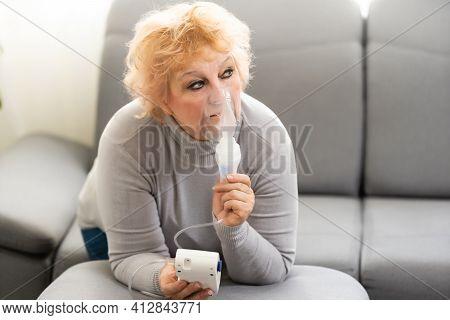 Sick Elderly Woman Making Inhalation, Elderly Woman And Nebulizer