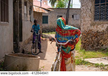 Nungwi, Tanzania - January 2020: Nungwi Village, Black African Kids On The Street Of Fisherman Villa