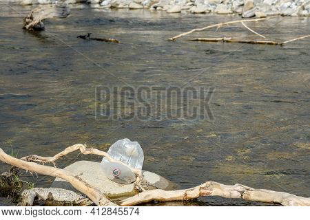 Discarded Plastic Bottle Trash Pollution On Contaminated Mountain River Ecosystem, Environmental Was