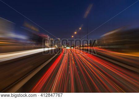 Night freeway traffic with motion blur in midtown Atlanta Georgia.