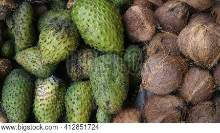 Heaps Of Soursop And Coconut Fruit In A Traditional Market