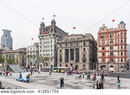 Shanghai, China - May 4, 2010: Historic Buildings With Chinese Flags Along The Bund, Aia, Chartered