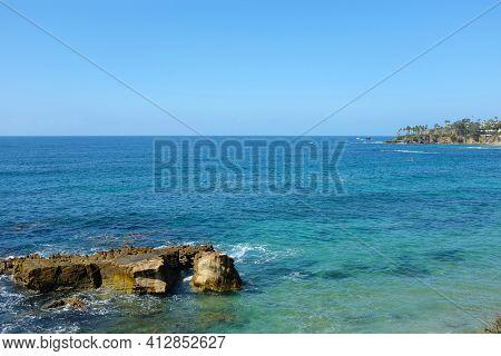 Rocks formation in the ocean at Laguna Beach a Southern California beach town.