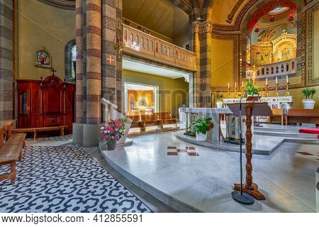 ALBA, ITALY - JUNE 23, 2020: Altar and confession booth as part of the interiors of Madonna della Moretta church in Alba - small town in Piedmont region famous for its white truffles and wines.