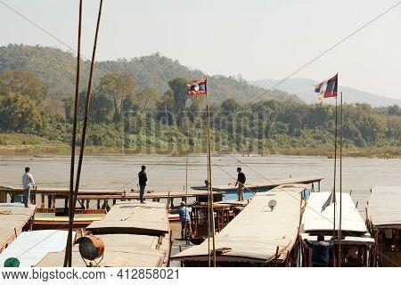 Luang Prabang - Dec 30,2016 : Tourists Enjoy The View Of Pak Ou Caves On Mekong River On December 30