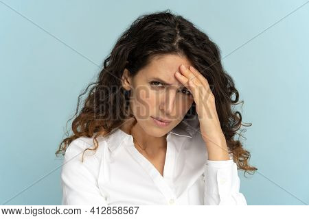 Displeased Business Woman Frowning, Irritated By Being Tired At Work, Touching Her Head Looking At C