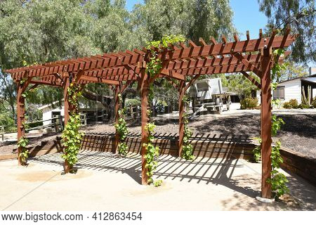 LAKE FOREST, CA - APRIL 14, 2017: Arbor at Heritage Hill Historical Park. The 4 acre park includes, 4 fully restored historic buildings from Saddleback Valley - El Toro.