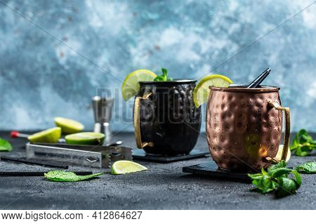 Ice Falling Into Copper Mug For A Moscow Mule Cocktail With Ginger Beer, Vodka, Lime. Banner, Menu R