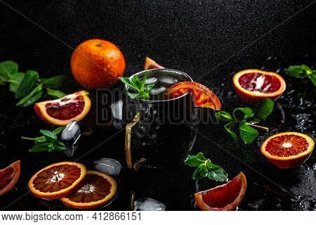 Moscow Mule Cocktail Splashing In Copper Cup With Blood Orange, Ginger Beer, Vodka And Mint, Banner,