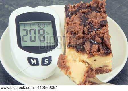 Glucometer For Checking And Measuring Sugar Level And Fresh Baked Cheesecake. Diabetes And Dieting D