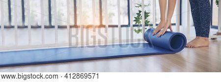 Banner Woman Hands Rolled Up Yoga Mat On Gym Floor In Yoga Fitness Training Room. Home Workout Woman