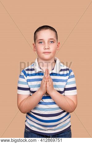 Little Boy Praying In The Morning. Portrait Of Kid Hand Praying. Calm Boy Praying To God With Hands