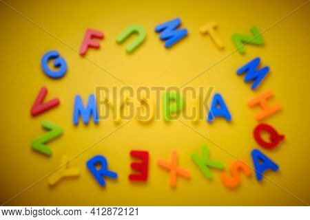 Defocused Word Myopia At Bright Yellow Background Made Of Colored Plastic Letters. Concept Of Visual