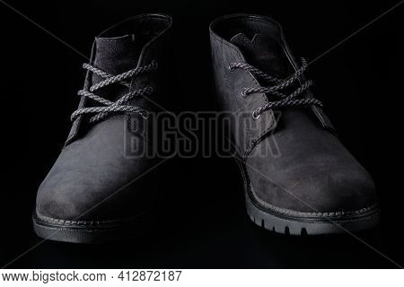 Black Chukka Boots Captured In Low Key. Black Mens Suede Shoes At Black Background