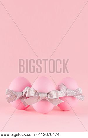 Simplicity Purity Easter Background - Pink Eggs With  Grey Bows On Pastel Pink, Vertical, Story.