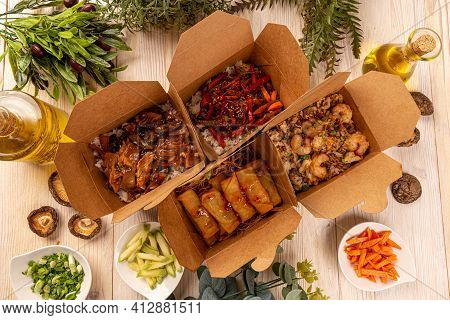 Flat Lay Of Chinese Takeaway Food Packaged In Special Boxe
