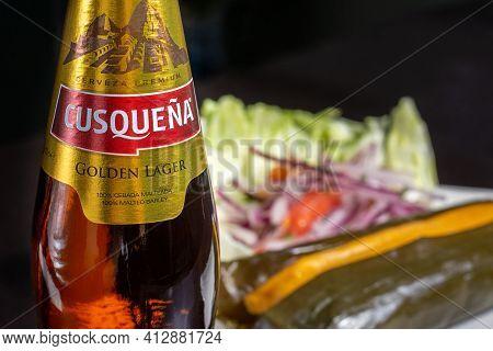 Cusco, Peru, 28.02.2021. Peruvian Beer Cusquena, Local Premium Beer And Peruvian Food