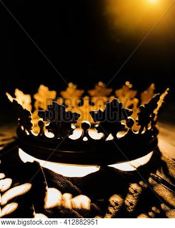 Vertical Photo For Posters And Banners. A Crown On A Black Background Is Highlighted With A Golden B