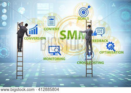 SMM - social media marketing concept with businessman