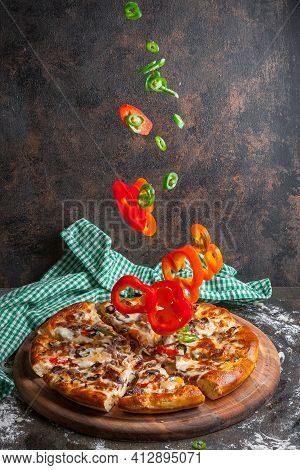 Side View Pizza With Slices Of Bell Pepper And Pizza Slices In Board Cookware On Stone Background