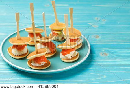 An Original Snack For Parties And Receptions. Mini Sandwich Of Pancake, Soft Cheese And Salmon. Dish