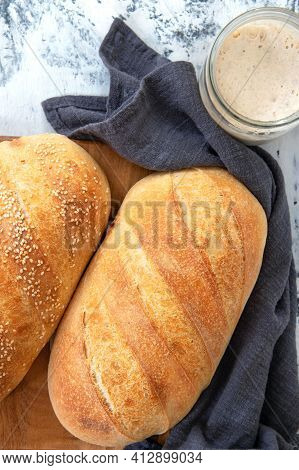Homemade White Bread, Loaf Of Sourdough Bread. Fresh Loaf Of Bread And A Glass Jar With Sourdough So