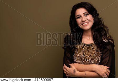 Portrait Of Beautiful Young Muslim Arabian Woman Wearing Hijab Looking At Camera, Copy Space