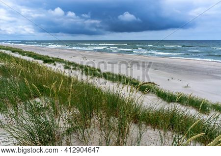 A Seashore Without People. A Deserted Sea Coast In Bad Weather. Wind And Waves On The Baltic Sea.
