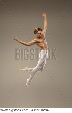 Aesthetic. Young And Graceful Ballet Dancer Isolated On Studio Background In Flight, Jump. Art, Moti