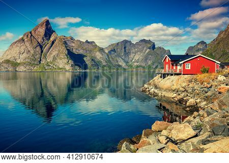 Beautiful Fishing Village On Fjord. Beautiful Nature With Blue Sky, Reflection In Water, Rocky Beach