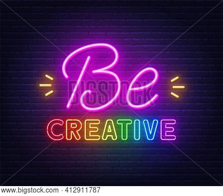 Be Creative Neon Inspirational Quote On A Brick Wall.