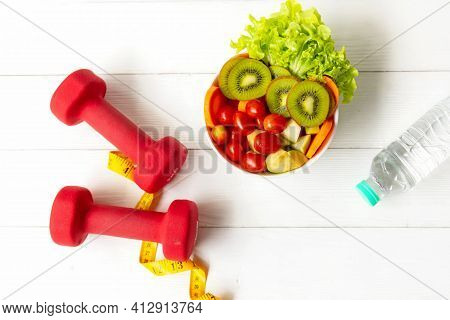 Diet Healthy Food And Lifestyle Health Concept. Sport Exercise Equipment Workoutandgym Background