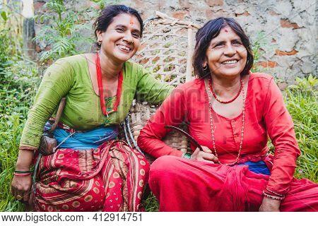 Happy Nepali Women On Traditional Attire In The Rural Village Of Nepal. Nepalese Women