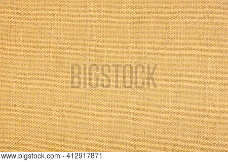 Fabric Background With Clear Canvas Texture. Yellow Colored Seamless Linen Texture Or Fabric Canvas