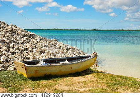 Old Fisher Ship On Beautiful Beach On The Caribbean Island Of Bonaire. Netherlands Antilles. Blue Oc