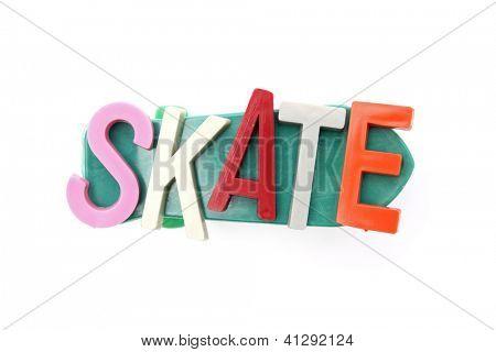 Plastic letters on a plastick skateboard.