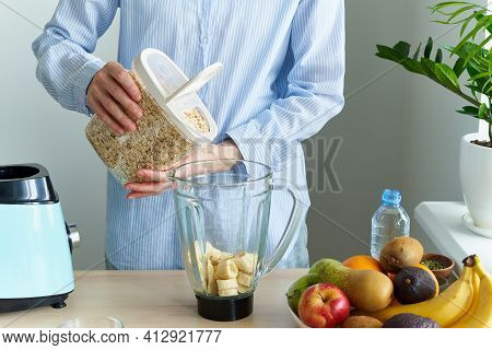 Raw Foodism, Rawism Smoothie With Banana And Gluten Free Oatmeal. Woman Pours Oatmeal To Blender, Ra