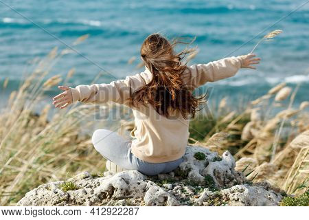 Young Yoga Woman Meditation Open Hands, Mindfulness On Seaside Rock Cliff Edge. Beautiful Sea View.