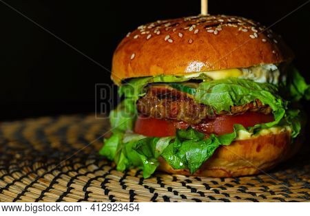Juicy Tasty Meat Burger With Cheese, Herbs And Vegetables, Ready To Eat.