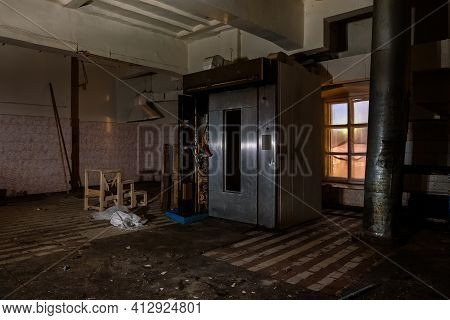 Abandoned Bakery. Old Rusty Equipment In Abandoned Factory.