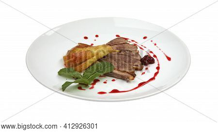 Sliced Roasted Duck Fillet With Pear And Berry Sauce On White Round Plate Isolated On White Backgrou