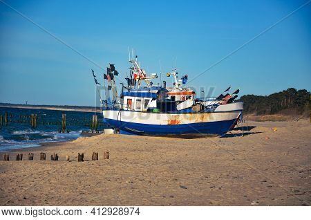 Fishing Boat On The Beach In The Unieście