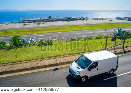Car On A Road In Front Of Madeira International Airport. Funchal, Madeira, Portugal