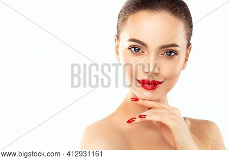 Beautiful Woman Showing Red  Manicure Nails . Makeup, Beauty And Cosmetics. Famele Beauty Face Care