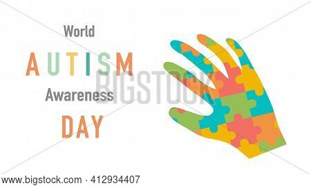 World Autism Awareness Day.  Autism Awareness Concept With Hand Of Puzzle Pieces For The Design Of B