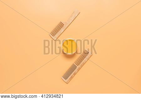 Nourishing Cream Hair Mask And Wooden Combs On A Pastel Yellow Background. Top View, Flat Lay