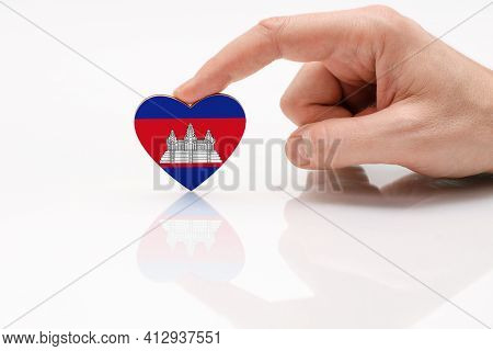 Cambodia Flag. Love And Respect Cambodia. A Man's Hand Holds A Heart In The Shape Of The Cambodia Fl