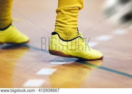 Indoor Football Player And Classic Ball. Futsal Training For Children. Legs Of Young Futsal Player I