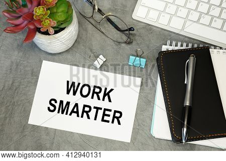 Work Smarter - Lettering On Paper On The Desktop, Notepad, Pen And Keyboard. Concept Photo Of The Ad