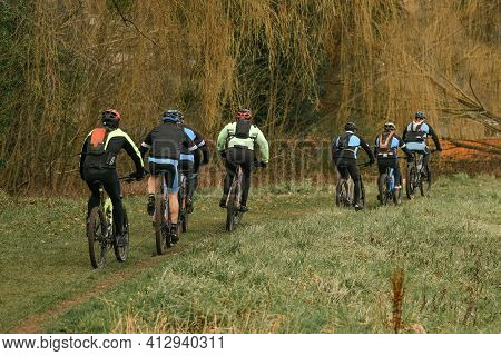 Group Of Cyclists Travel By Bike In A Forest